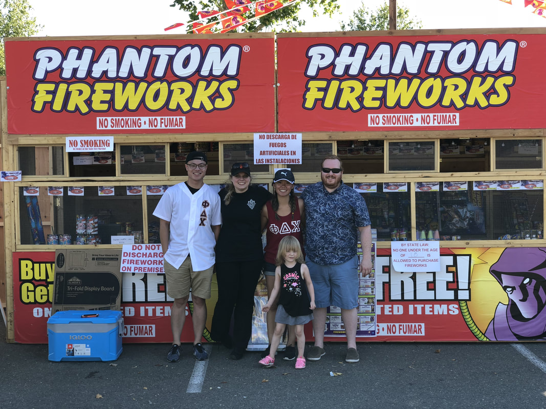 photo of a group of people in front of a phantom stand